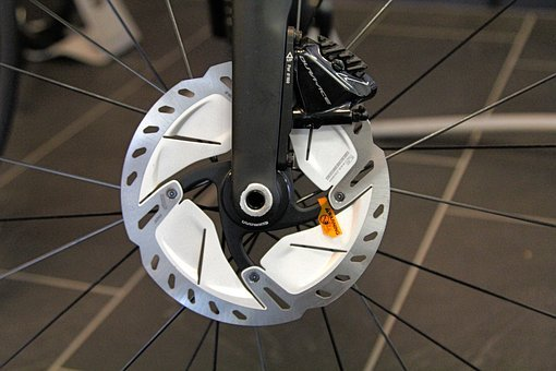 close up of two piece disc brake and caliper on bicycle wheel